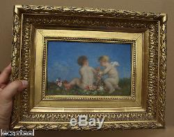 Huile sur bois deux amours brassant des fleurs putti 19ème siècle