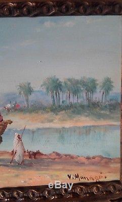 Huile sur panneau signée V MANAGO caravane dans le désert