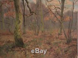 Huile sur toile signée Bousquet représentant un sous bois