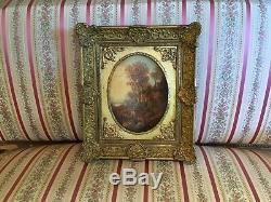 Peinture du XIXe Paysage accompagné de son cadre en médaillon doré