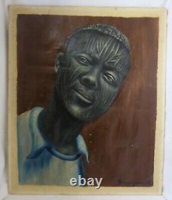 Portrait d'homme africain scarifié XX ème signé AMOUGOU. R
